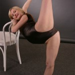Young ballet dancer Masha performs provocative exercises with a chair